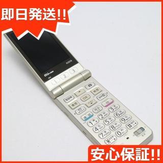 キョウセラ(京セラ)の美品 au K003 簡単ケータイ ゴールド 白ロム(携帯電話本体)