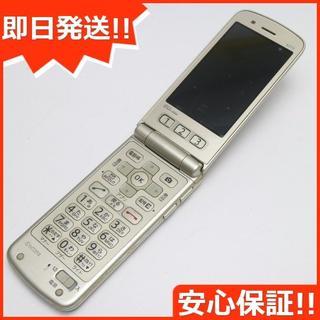 キョウセラ(京セラ)の良品中古 au K010 ゴールド 白ロム(携帯電話本体)
