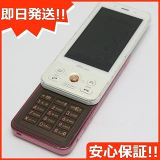 ソニー(SONY)の美品 au S002 プレシャスピンク 白ロム(携帯電話本体)