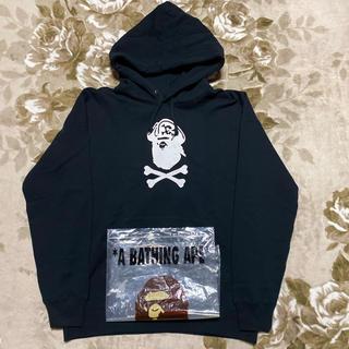アベイシングエイプ(A BATHING APE)のAPE BAPE PIRATE STORE KAWS パーカー 黒 2XL(パーカー)