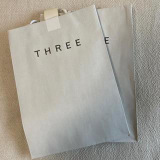 スリー(THREE)のTHREE ショッパー 紙袋 セット(ショップ袋)