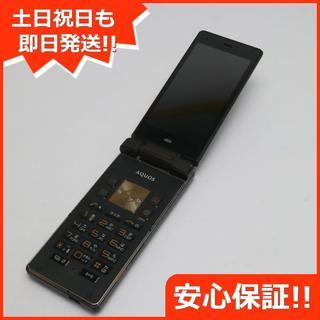 シャープ(SHARP)の美品 au SHF31 AQUOS K ブラック (携帯電話本体)