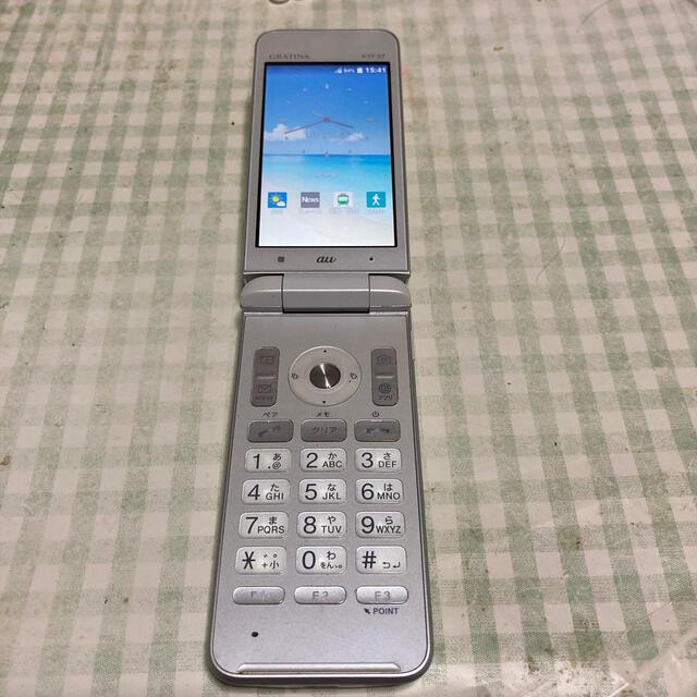 京セラ(キョウセラ)のau 京セラ 4Gガラホ グラディナKYF37シルバ–おまけ別売り充電器 スマホ/家電/カメラのスマートフォン/携帯電話(携帯電話本体)の商品写真