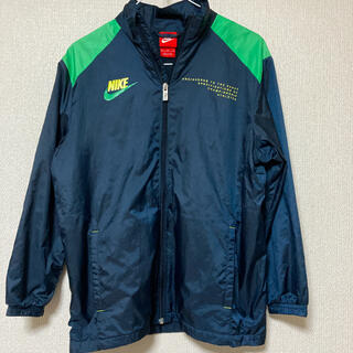 ナイキ(NIKE)のNIKE ナイロンジャケット 紺色(肩:緑) Mサイズ(ナイロンジャケット)