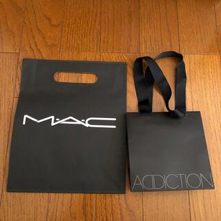 スリー(THREE)のTHREE CLARINS ADDICTION MACLANCOME SUQQU(ショップ袋)