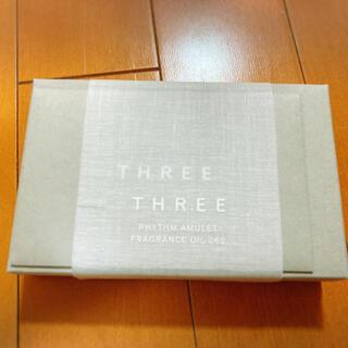 スリー(THREE)のTHREE リズムアミュレット フレグランスオイル 062 オーデコロン(香水(女性用))