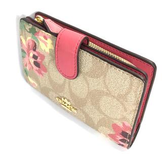 COACH - コーチ COACHベージュのシグネチャーフローラル可憐な花柄の折財布