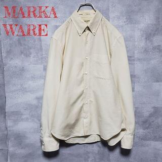 マーカウェア(MARKAWEAR)の【良品】 マーカウェア 長袖シャツ アイボリー 無地 シンプル(シャツ)
