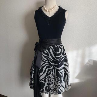 ビーシービージーマックスアズリア(BCBGMAXAZRIA)のMade in Italy リボン付きバルーンスカート(ひざ丈スカート)