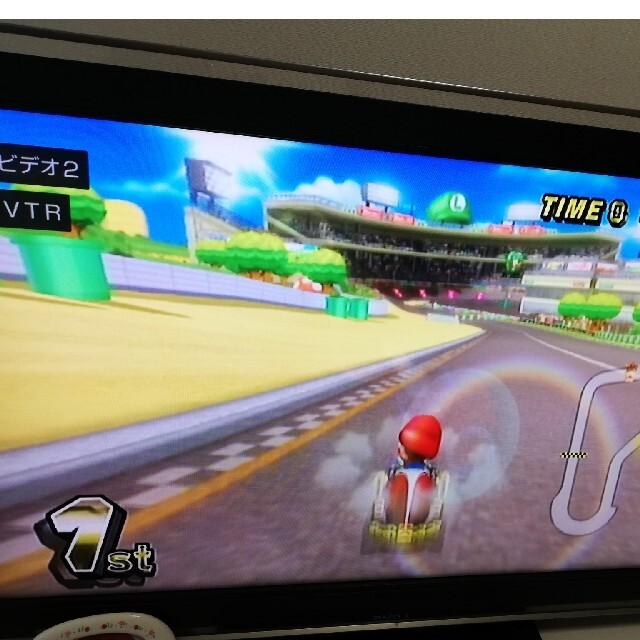 Wii(ウィー)のマリオカート wii ソフト ハンドル付き 起動確認 エンタメ/ホビーのゲームソフト/ゲーム機本体(家庭用ゲームソフト)の商品写真