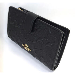 COACH - コーチ COACH凹凸の人気の黒シグネチャー パテント レザーが光沢の折財布