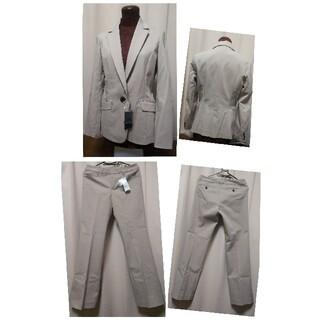 アーヴェヴェ(a.v.v)の【新品タグ付き】a.v.v ベージュ パンツスーツ サイズM(スーツ)