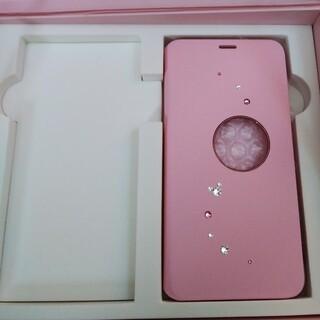 エヌティティドコモ(NTTdocomo)のドコモ ディズニーモバイル DM01k 純正オリジナルカバー ピンク(モバイルケース/カバー)