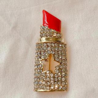 ディオール(Dior)の最終値下 口紅のブローチ スターモチーフ きらきら バッチ コサージュ リップ(ブローチ/コサージュ)