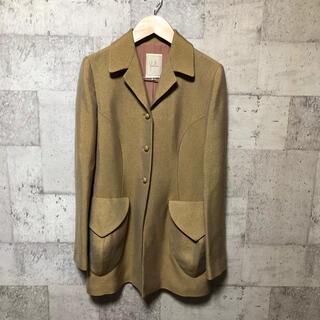 シビラ(Sybilla)のSybilla シビラ テーラードジャケット ミドル丈 デザインポケット 光沢感(テーラードジャケット)