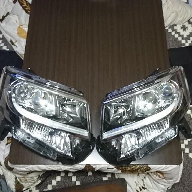 ダイハツ(ダイハツ)のダイハツ タントカスタムマイナー後ヘッドランプ てげてげ様専用 自動車/バイクの自動車(車種別パーツ)の商品写真