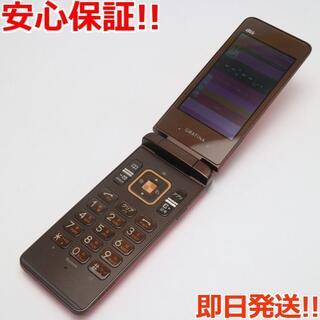 キョウセラ(京セラ)の美品 au GRATINA オレンジ 白ロム(携帯電話本体)