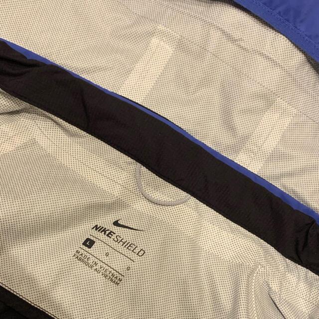 NIKE(ナイキ)のNIKE ナイロンジャケット 青 黒 レディース レディースのジャケット/アウター(ナイロンジャケット)の商品写真