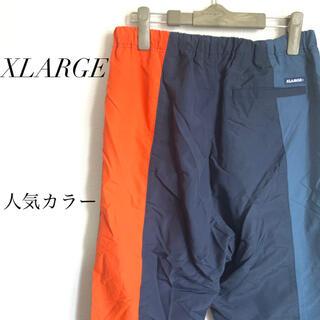 エクストララージ(XLARGE)のXLARGE ナイロンパンツ バイカラー 古着  オレンジ トラックパンツ(その他)