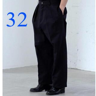 コモリ(COMOLI)のNEAT / ニート USA ブラック 32(チノパン)