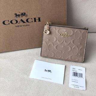 コーチ(COACH)のタグ付き新品★COACH コーチ 二つ折り財布 シグネチャーレザー ベージュ(財布)