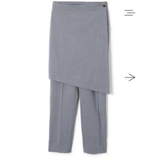 トーガ(TOGA)のsoduk スドーク wrap stripe trousers gray パンツ(カジュアルパンツ)