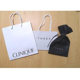 スリー(THREE)のショッパー&ラッピング<THREE、CLINIQUE>(ショップ袋)