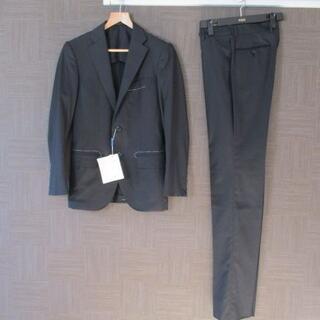トゥモローランド(TOMORROWLAND)の新品 トゥモローランド 黒 スーツ 42 小さいサイズ(セットアップ)