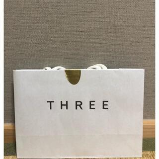 スリー(THREE)のTHREE紙袋(ショップ袋)