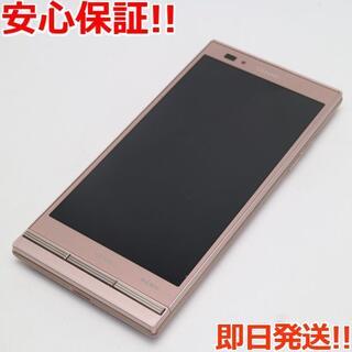 キョウセラ(京セラ)の美品 au URBANO L02 ピンク 白ロム(スマートフォン本体)