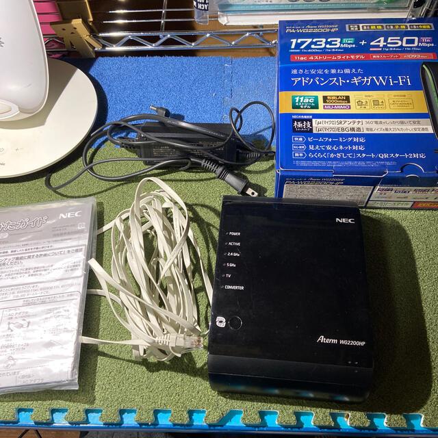 NEC(エヌイーシー)のNEC wi-fiホームルーター PA-WG2000HP スマホ/家電/カメラのPC/タブレット(PC周辺機器)の商品写真