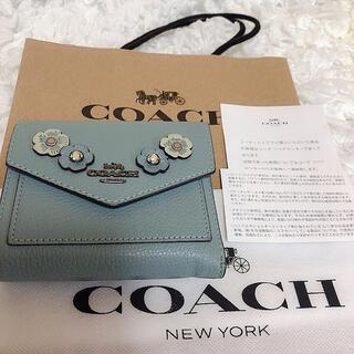 コーチ(COACH)のCOACH コーチ 水色 ワッペン ビジュー ミニ財布 ウォレット 花柄 青 緑(財布)
