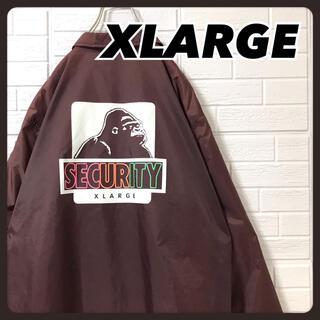 エクストララージ(XLARGE)のエクストララージ コーチジャケット 茶色 バックプリント SECURITY(ナイロンジャケット)
