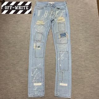 オフホワイト(OFF-WHITE)のOFF-WHITE Flont Logo Paint Damage Jeans(デニム/ジーンズ)