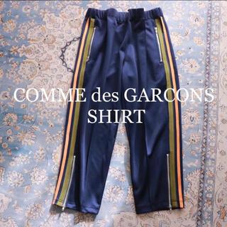 コムデギャルソン(COMME des GARCONS)のCOMME des GARCONS SHIRT クロップドイージートラックパンツ(スラックス)