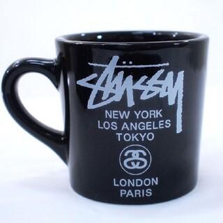 ステューシー(STUSSY)のSTUSSY ノベルティー マグカップ 黒(グラス/カップ)