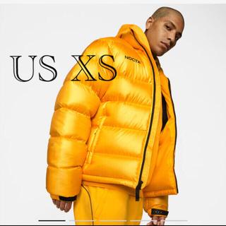 ナイキ(NIKE)のNOCTA x Nike Puffer Jacket yellow(ダウンジャケット)