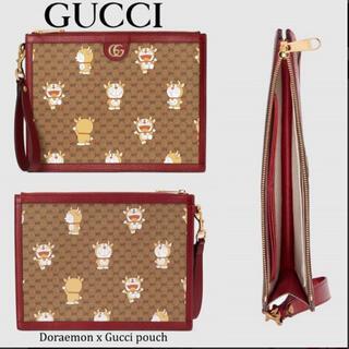 Gucci - GUCCIグッチ x ドラえもん ポーチ GG クラッチバック牛ドラえもん限定品