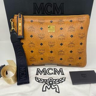 エムシーエム(MCM)の新品☺︎MCM エムシーエム クラッチバッグ キャメル 総柄 ストラップ(クラッチバッグ)