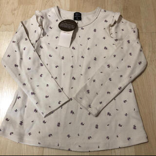 プティマイン(petit main)のpetit main オーガニックコットン 肩フリル花柄Tシャツ(Tシャツ/カットソー)