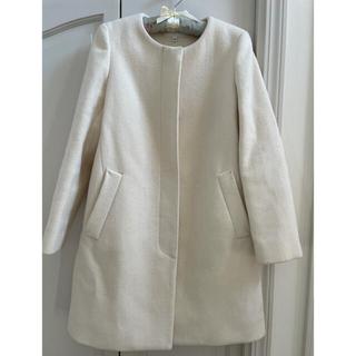 UNIQLO - ウールのノーカラー ホワイトコート ミディアム丈