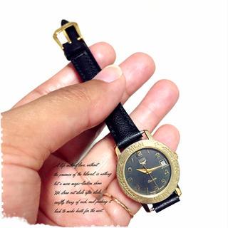 エムシーエム(MCM)のMCMブラック×ゴールド日付つき腕時計(腕時計)