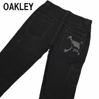 オークリー(Oakley)のオークリー スカル刺繍 8ポケット ブラックチノパン ストレッチ素材入り 32(チノパン)