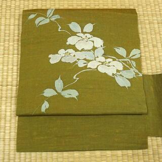 梅幸茶色の紬地に椿 名古屋帯(帯)