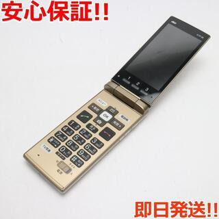 キョウセラ(京セラ)の美品 KYF38 かんたんケータイ シャンパンゴールド (携帯電話本体)