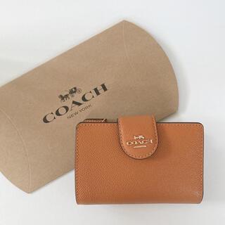 コーチ(COACH)のCOACH 折り財布 オレンジ暗め(財布)