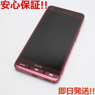 キョウセラ(京セラ)の美品 SIMロック解除済 KYV43 レッド 本体 白ロム (スマートフォン本体)