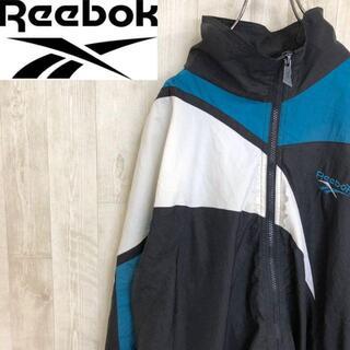 リーボック(Reebok)のリーボック ナイロンジャケット パーカー フーディー ワンポイント刺繍ロゴ(ナイロンジャケット)