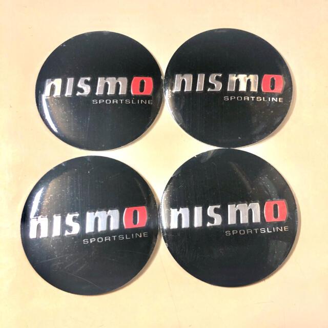 日産(ニッサン)のnismo  ニスモ ホイールセンターキャップ&ステッカーセット 自動車/バイクの自動車(車外アクセサリ)の商品写真