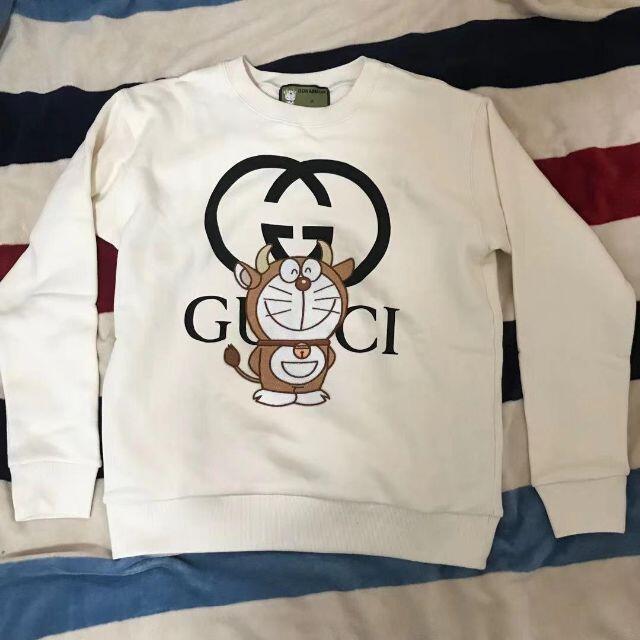 Gucci(グッチ)のGUCCI x DORAEMON グッチ ドラえもん 牛柄 スウェット メンズのトップス(パーカー)の商品写真